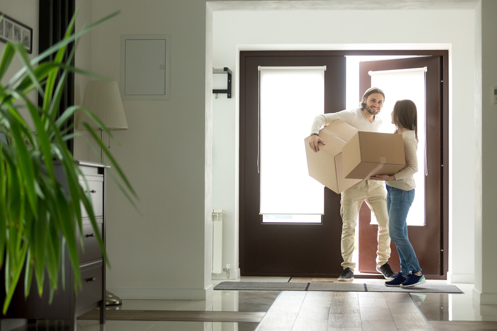 Couple moving in boxes