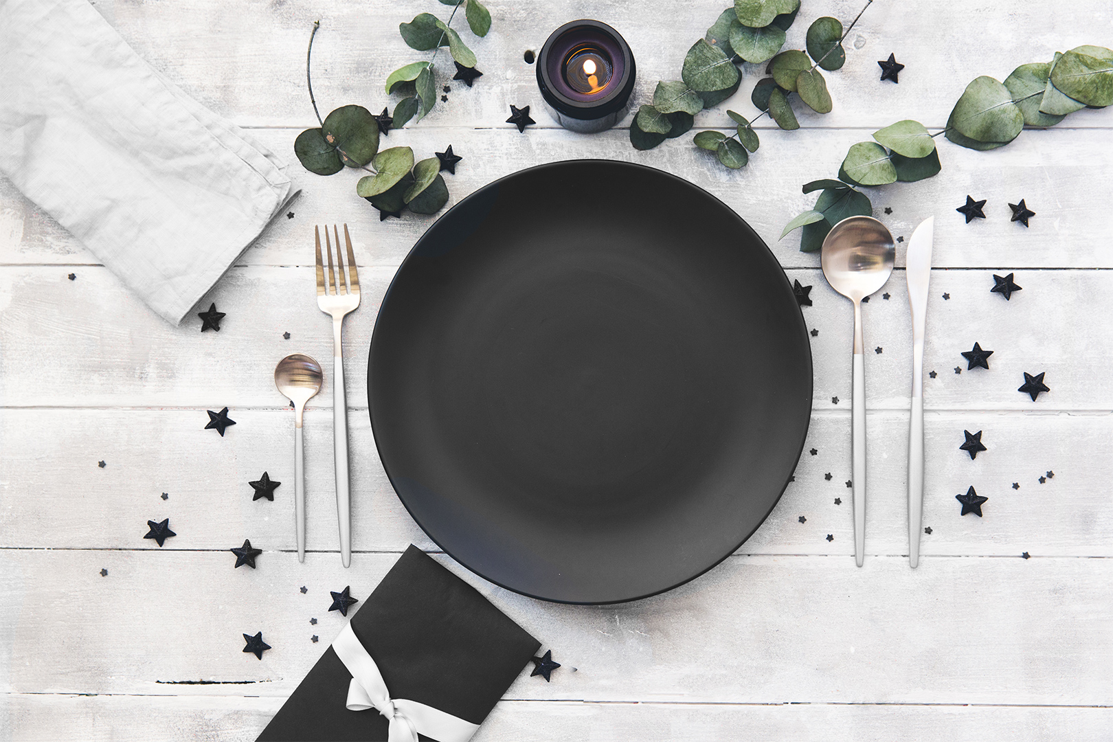 dinner setting with black plate
